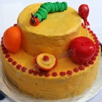 A healthy birthday party cake- whole wheat carrot, orange cake featuring The Very Hungry Caterpillar on carrot frosting (Fiesta Fridays- #8)