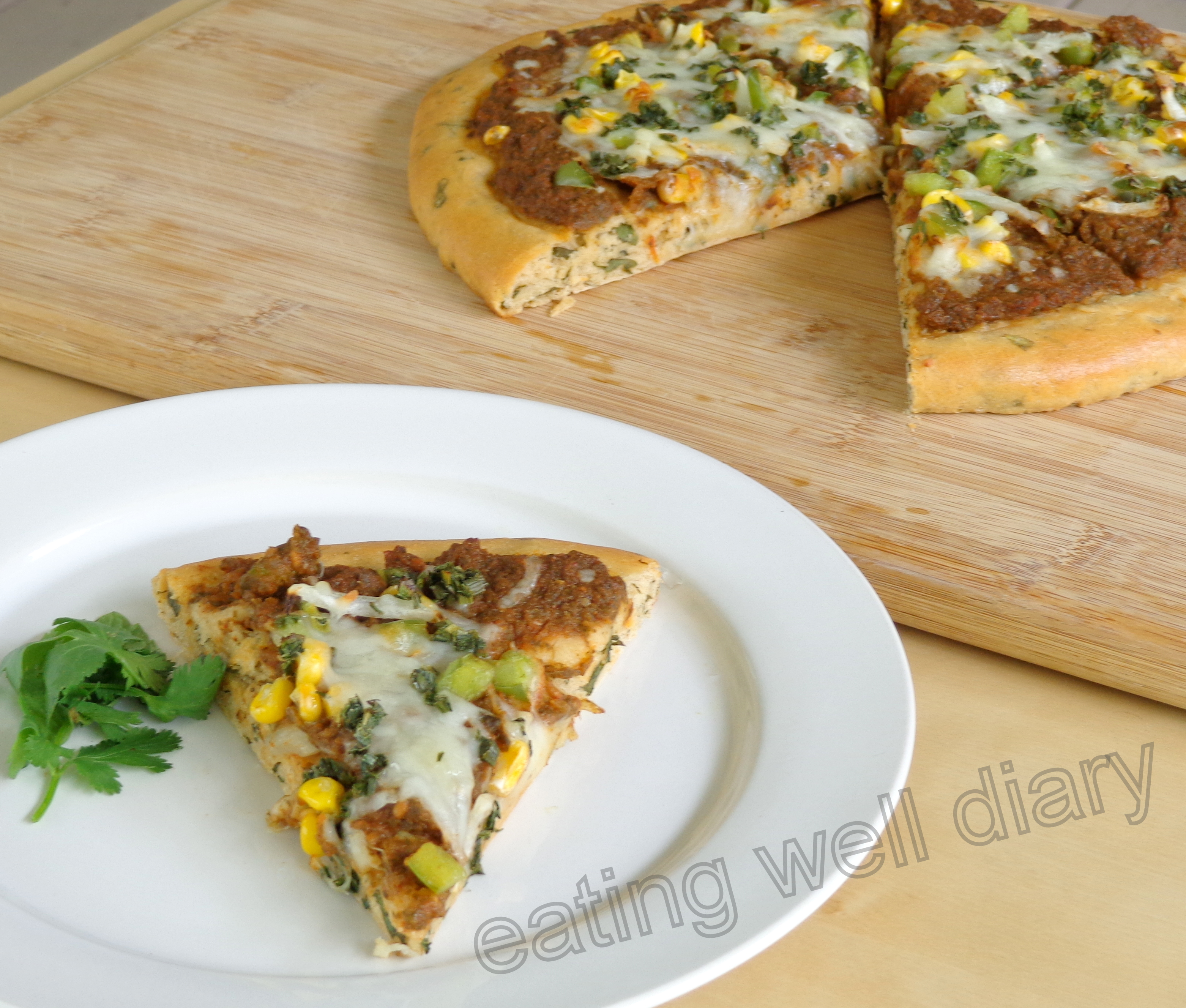 Herb-loaded pizza with homemade sauce (whole wheat)- Fiesta Friday Challenge 1
