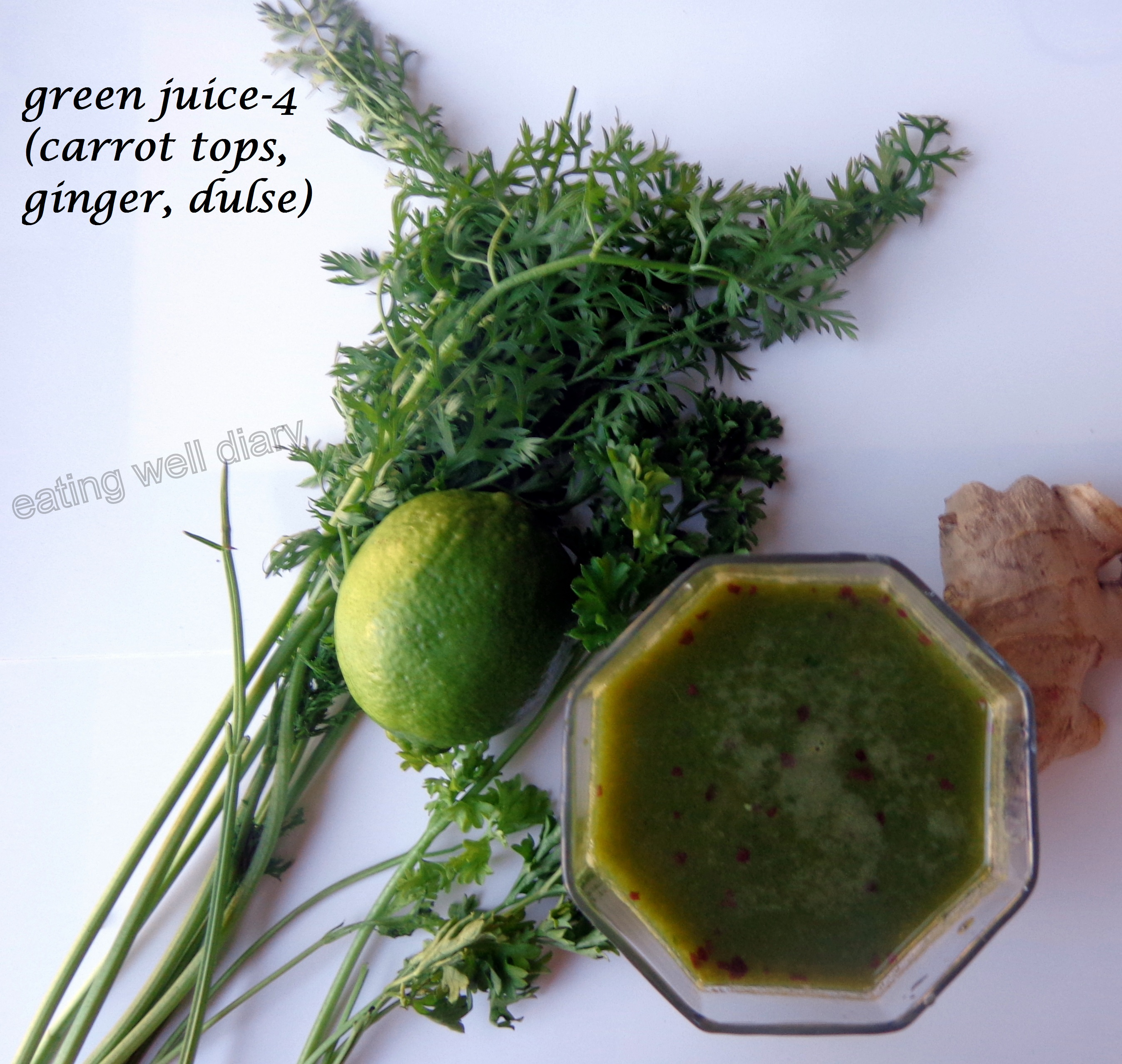 Green juice with carrot tops, ginger and dulse flakes