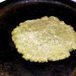 Heating one side of roti